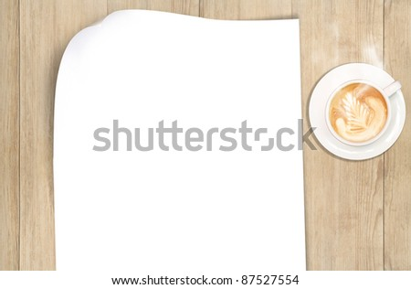 Blank Paper ready for your own text and coffee on the table - stock photo