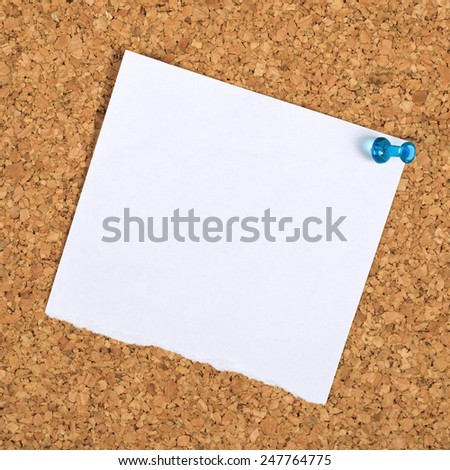 Blank Paper Reminder Note Pinned to a Cork Memory Bulletin Board as Copy Space for Your Message - stock photo