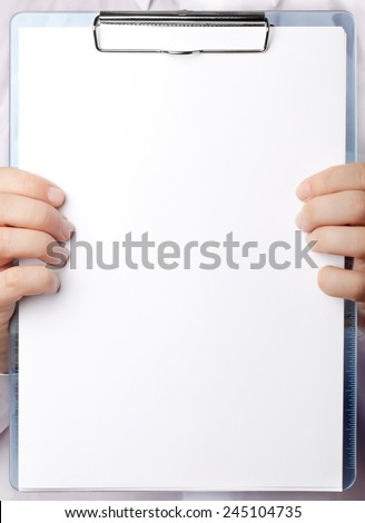 Blank paper sheet in hands  - stock photo