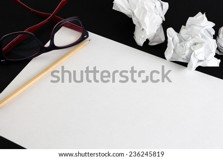 Blank paper sheet with pencil and crumpled papper balls isolated  - stock photo