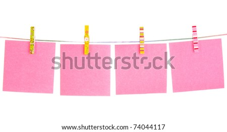 Blank paper sheets on a clothes line on a white background