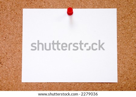 Blank paper stuck to a notice board, ready for your message. - stock photo