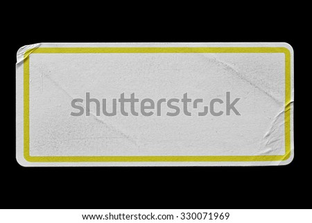 Blank Paper Tag or Label with Yellow Border isolated on Black Background. Sticker or Paper Adhesive with Wrinkles and Scratches. Close Up. Top View with Copy Space for Text or Image - stock photo