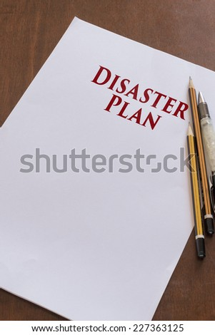 Blank paper with Disaster Plan word. - stock photo