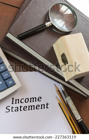 Blank paper with Income Statement word. - stock photo