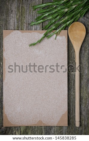 Blank paper with space for text, spoon and fresh rosemary on old wooden background, close-up - stock photo