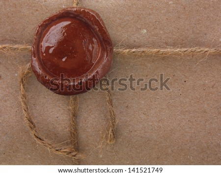 Blank paper with wax seal stamp. - stock photo
