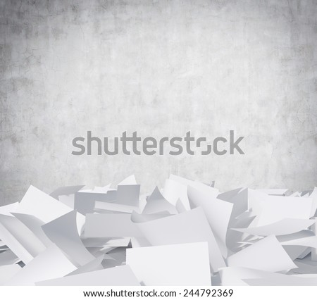 blank papers heap on a gray wall background - stock photo