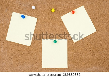 Blank papers pin up on cork board.