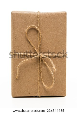blank parcel with bow isolated on white - stock photo