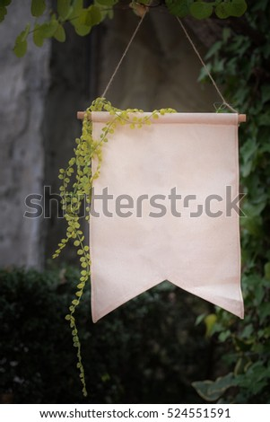 blank party flag with ivy in garden for montage text