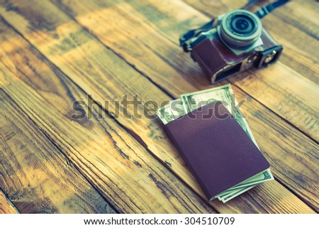 Blank passport with US dollars on wood table  ( Filtered image processed vintage effect. ) - stock photo