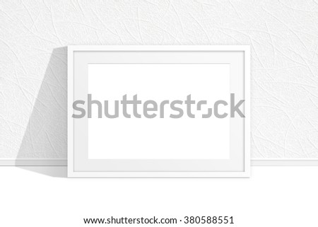 Blank photo frame near the wall with new modern wallpaper - stock photo