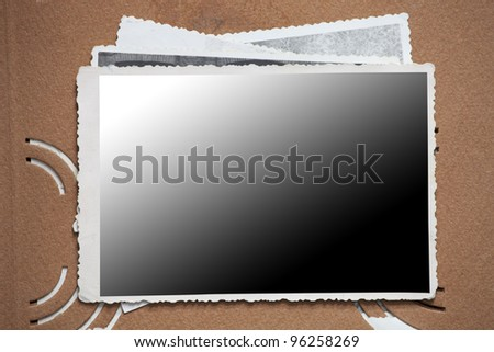 Blank photo frame on a stack of old photos. Clipping path included for easy isolation - stock photo