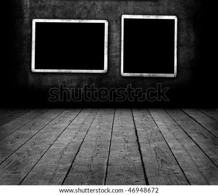 Blank photo frame on wall - stock photo
