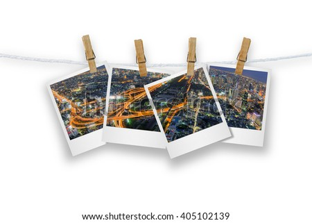 Blank photo frame  with clothespin hanging, photo cityscape and transport of Bangkok, Isolated on white with clipping path. - stock photo