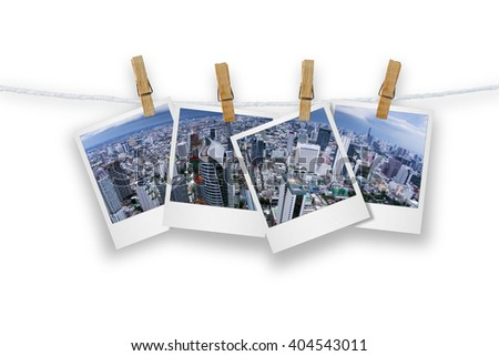 Blank photo frame  with clothespin hanging, photo cityscape skyscrapers of Bangkok, Isolated on white with clipping path.
