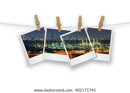 Blank photo frame  with clothespin hanging, photo oil refinery of Bangkok isolated on white with cutting path.