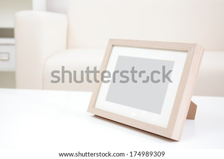 blank photo frame with copy space on white table at home - stock photo
