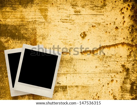 Blank photo frame with textured grunge background