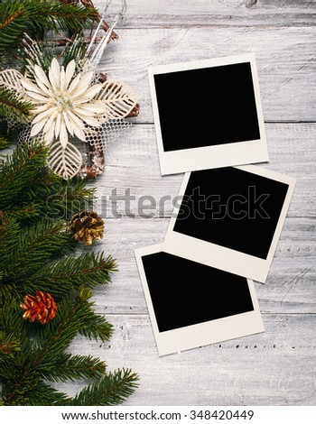 Blank photo frames and christmas decoration on white wooden table. - stock photo