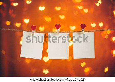 Blank photo frames hanging on the heart clothesline. Valentines day concept - stock photo