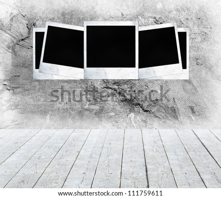 Blank photo frames on aged wall
