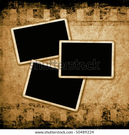 Blank photo frames on grunge wall - stock photo