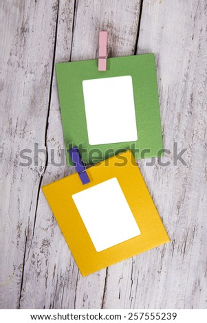 Blank  photo frames on old wooden background - stock photo