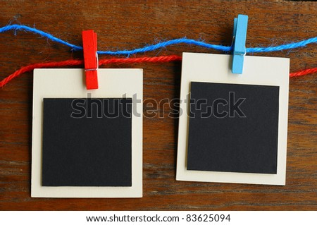 Blank photo frames on red and blue line - stock photo