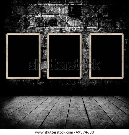 Blank photo frames on wall with film strip texture - stock photo