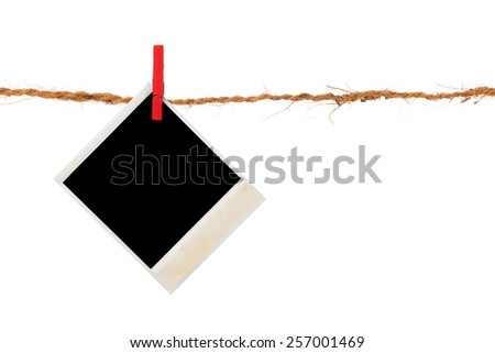 Blank photo hanging on a clothesline over white background - stock photo