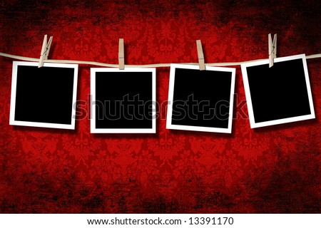 Blank photographs hanging with grungy velvet background - stock photo