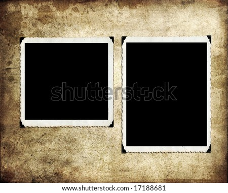 Blank photographs on a grungy paper background - stock photo