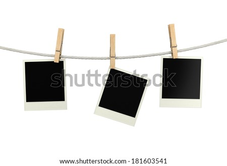 Blank photos hanging on a clothesline - stock photo