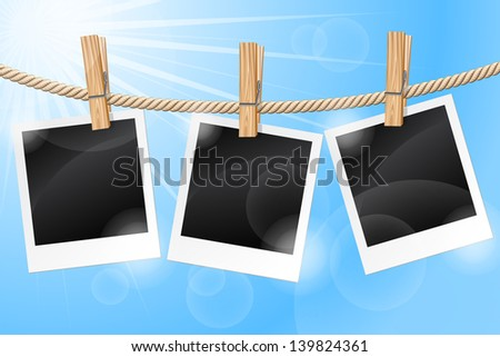 Blank photos hanging on a clothesline against a blue sky. Raster version. Vector is also available in my gallery - stock photo