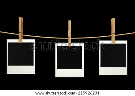 Blank photos hanging on a clothesline. realistic. isolated on black background. 3d illustration - stock photo