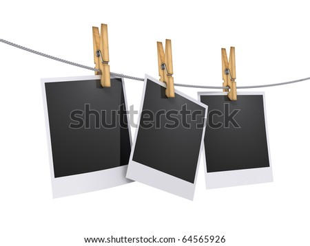 Blank photos hanging on rope