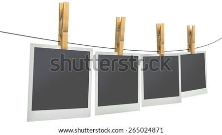 blank photos on clothesline, isolated white background - stock photo