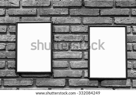Blank picture border on the white brick wall. - stock photo