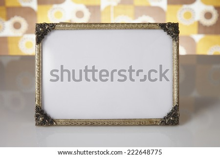 Blank picture frame against kitsch background - stock photo