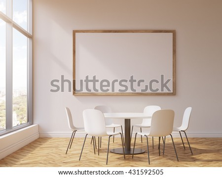 Blank picture frame and round table with chairs in conference room interior with concrete wall, wooden floor and window with city view. Mock up, 3D Rendering - stock photo