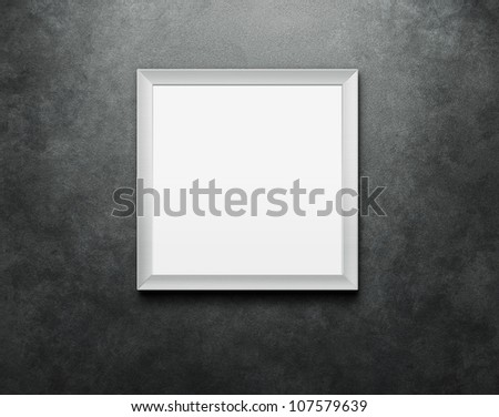 Blank picture frame at the concrete wall with clipping path for the inside - stock photo