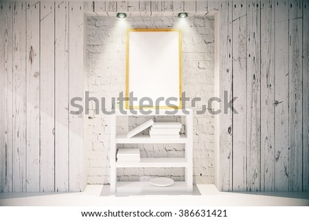 Blank picture frame hanging above white bookshelf on brick wall in light wooden interior design room with lights. Mock up, 3D Render - stock photo