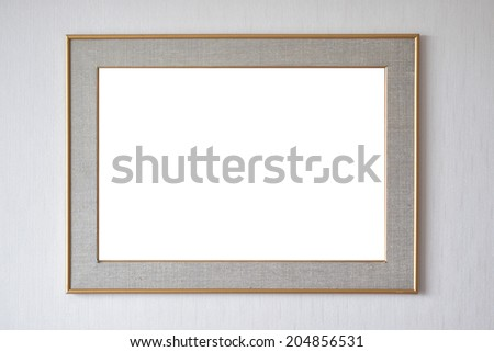 Blank picture frame hanging on wall - stock photo