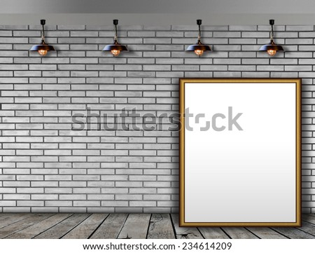 Blank picture frame on the brick wall and the wooden floor