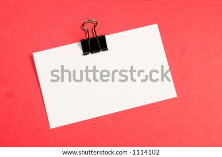 Blank piece of white paper on a red board