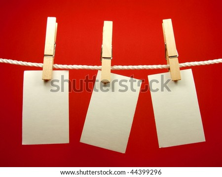 Blank pieces of paper hang on clothesline