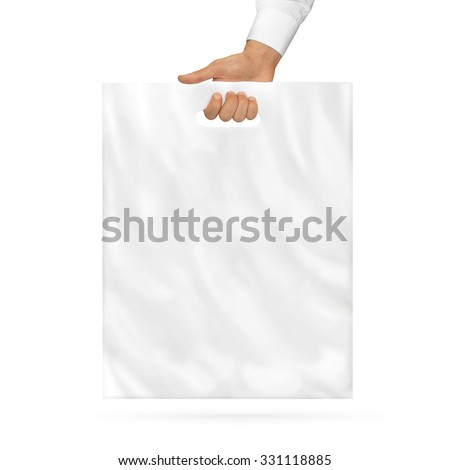 Blank plastic bag mock up holding in hand. Empty polyethylene package mockup hold in hands isolated on white. Consumer pack ready for logo design or identity presentation. Product food packet handle. - stock photo