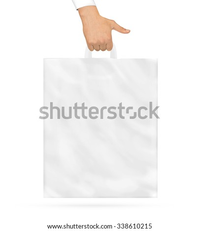 Blank plastic bag mock up holding in hand. Empty polyethylene package mockup hold in hands isolated on white. Pack ready for logo design or supermarket identity presentation. Product store packet. - stock photo